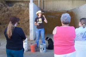 Ange Kapperman talks about cattle nutrition at Doug Van Duyn's feed lot near Colton, SD.