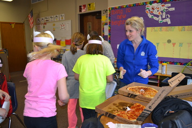 Hannah Walkes serving pizza at Valley Springs Elementary during National Ag Week visits